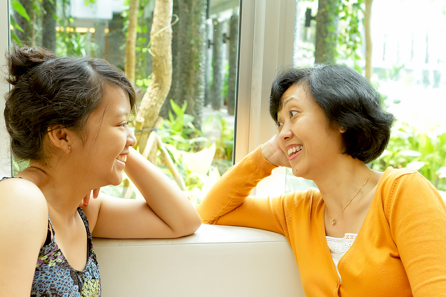 asian mother and daughter talking happy